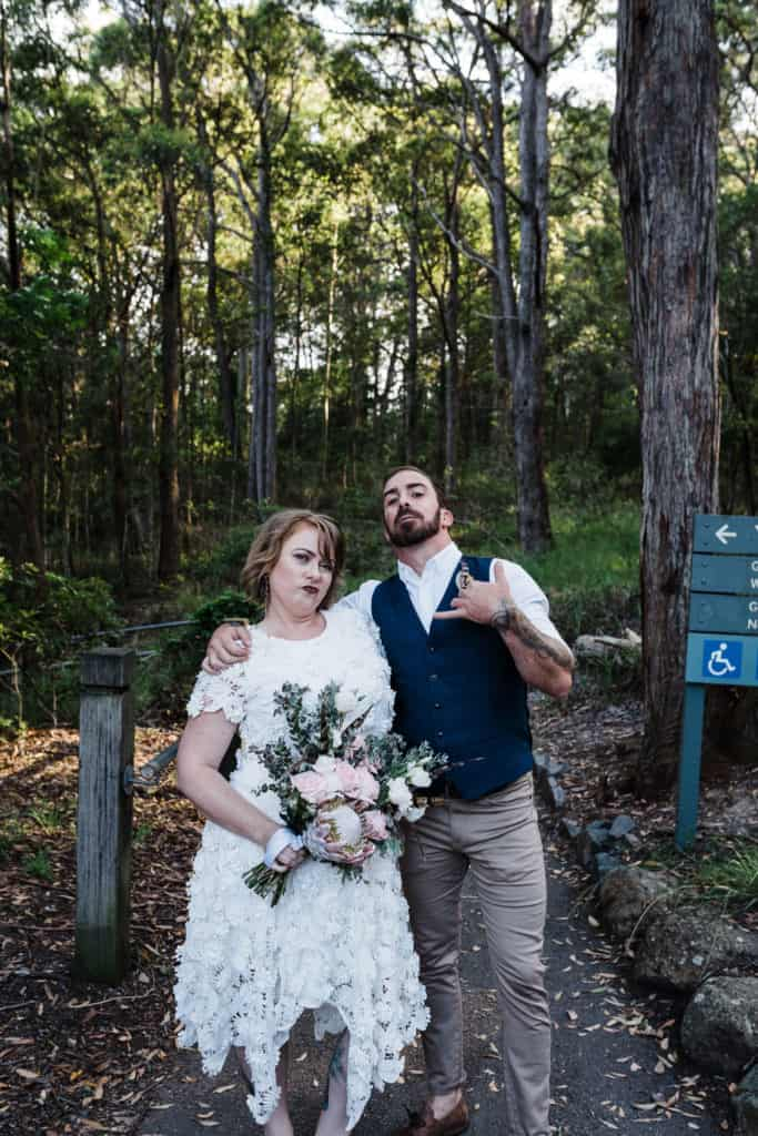 bride and groom about to start trek to elopement ceremony location in Glenrock captured by james white newcastle wedding photographer