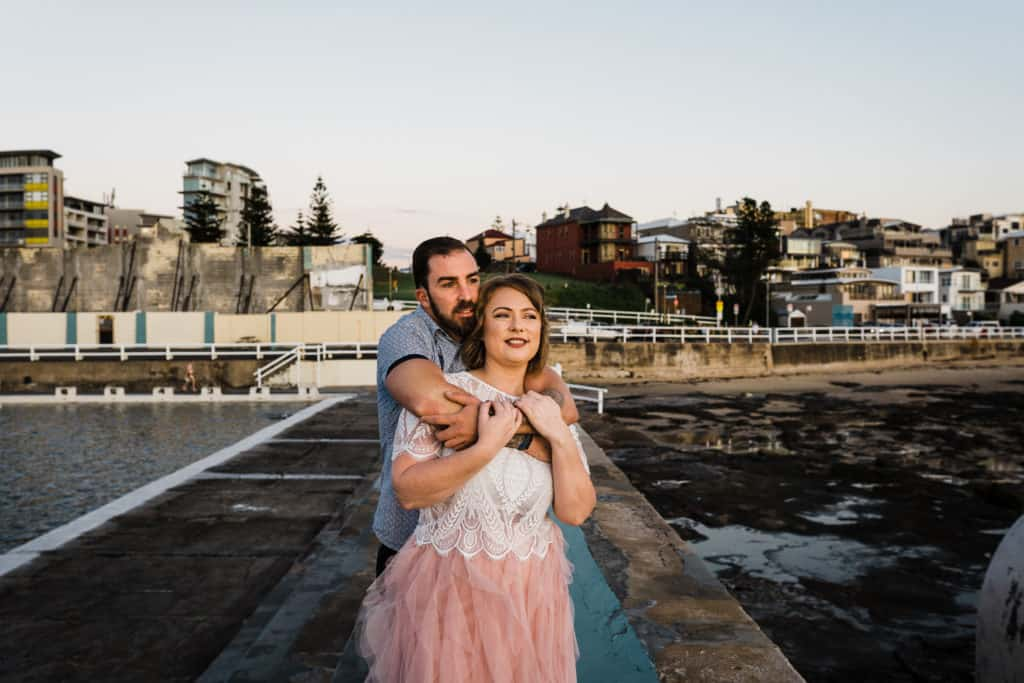 bride and groom embracing under the sun as it rises captured by james white newcastle wedding photographer