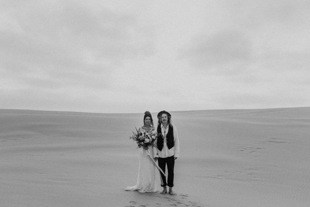 bride and groom eloping on stockton sand dunes