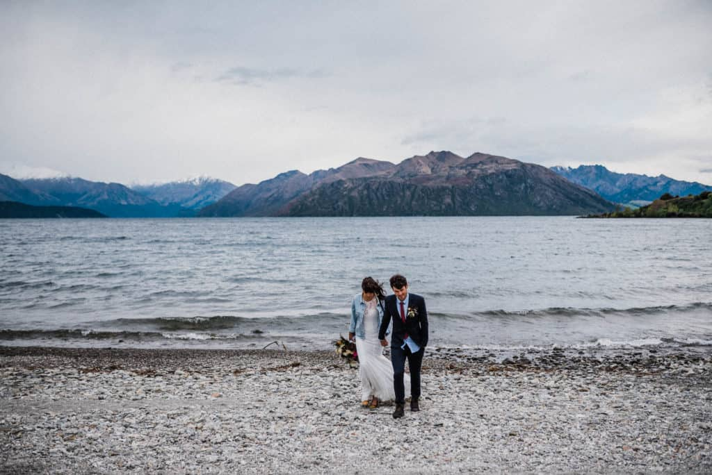 Stunning new zealand lake and mountains backdrop for elopement portraits of bride and groom