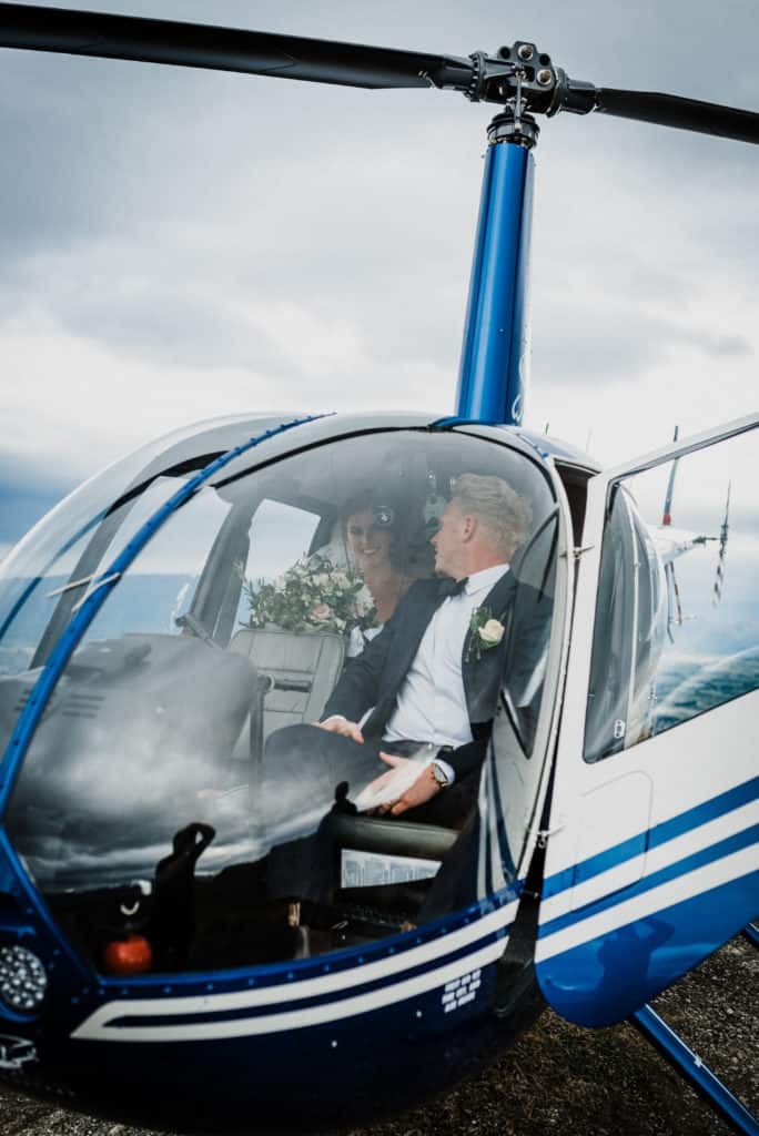 Bride and groom jump in helicopter on top of Coromandel Peak after eloping in NZ.
