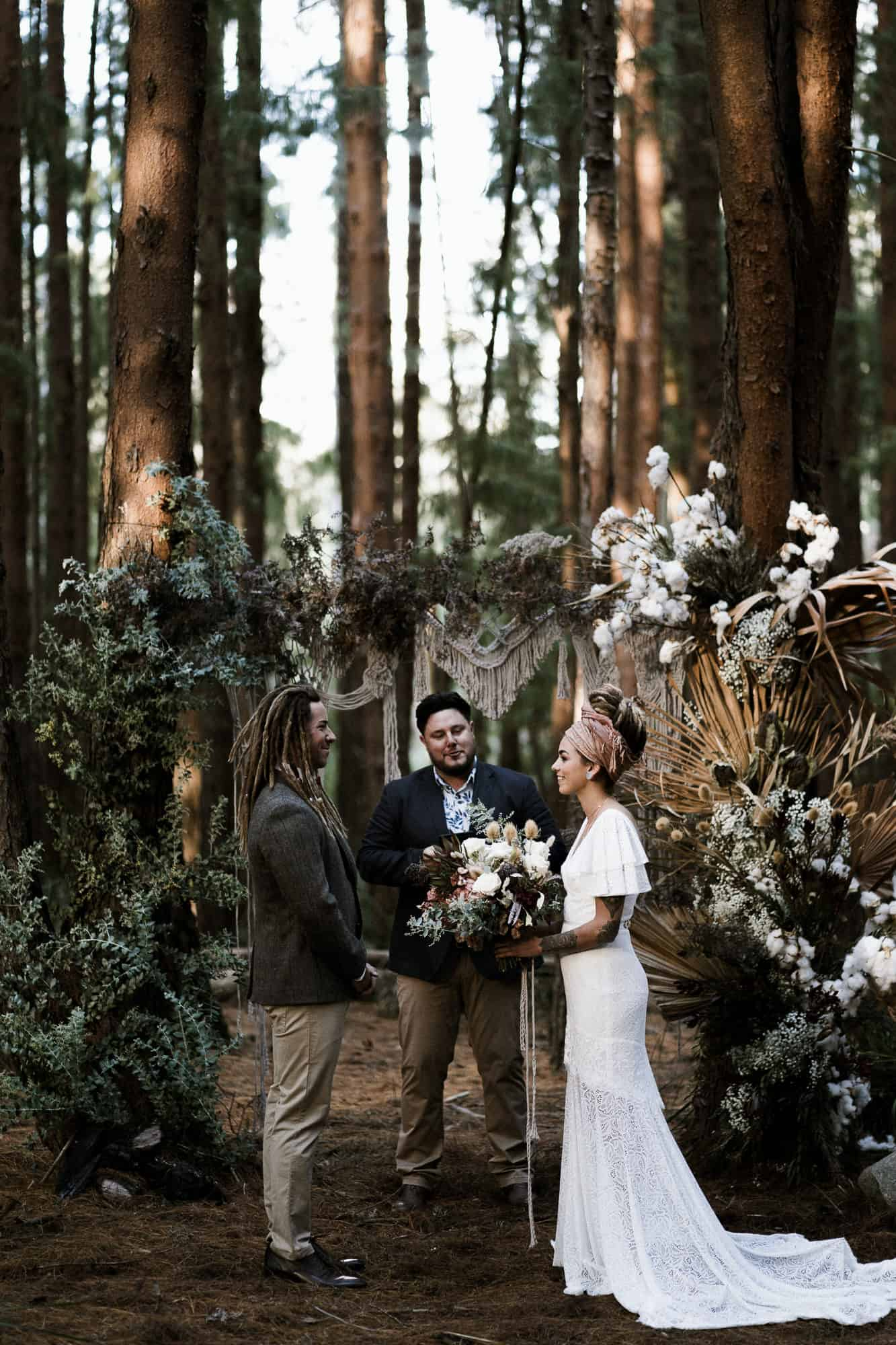 bride and groom with dreamy moody forest elopement ceremony